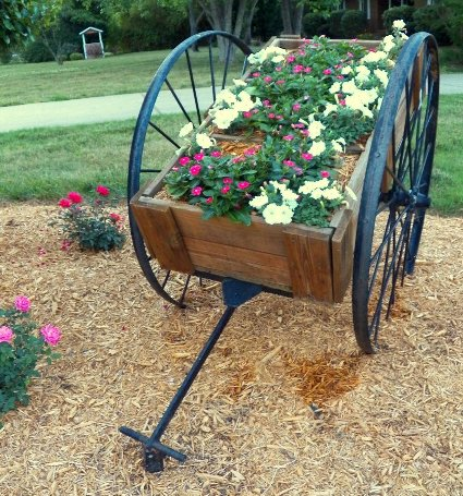 Melynn Layton's large rustic flower cart is stunning!