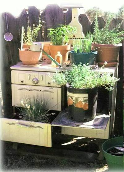 Billie J Mather-Clemons's unique potting table in a cast off stove!