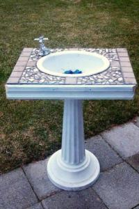 Lyn Engstrom's modern tiled sink would accent an outdoor bath 'room' in the garden.