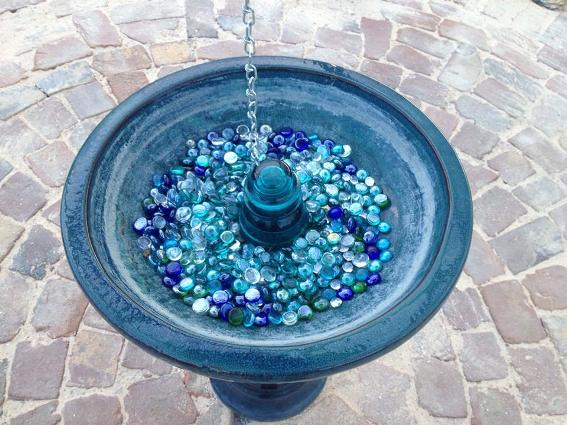 This birdbath, all in blue, was placed in the very center