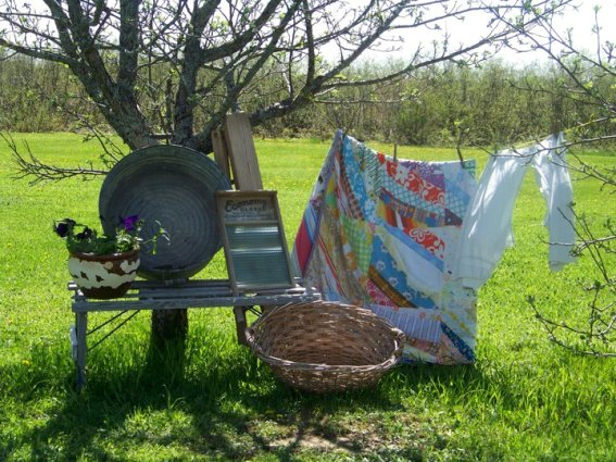 Brigid Williams laundry day vignette also makes use of a tree backdrop