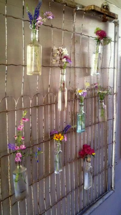 Christy Thomas wire gate acts as a frame for her bottle 'vases'