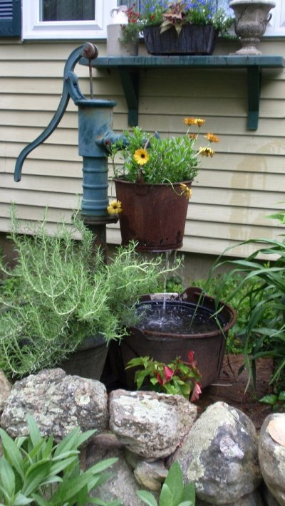 Pump and rusty bucket fountain