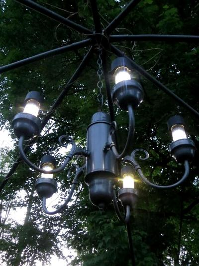 Theresa Jones ‎added black solar lights to a simple chandelier