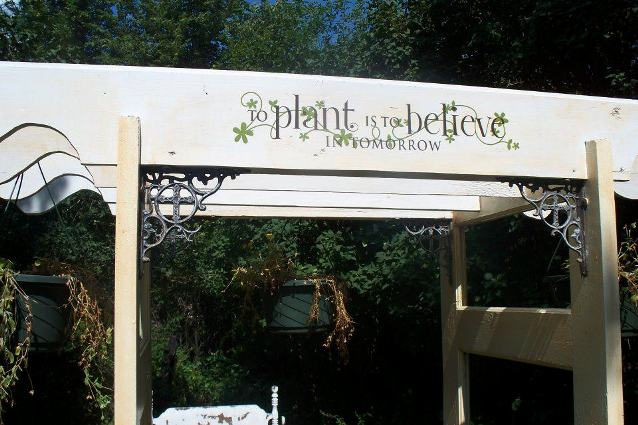 "Sue's sign says, ""To Plant is to Believe in Tomorrow"""