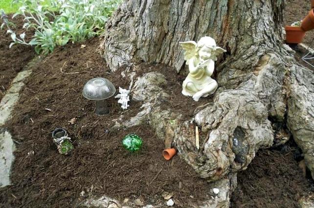 Allison Reagan mulches her tiny garden