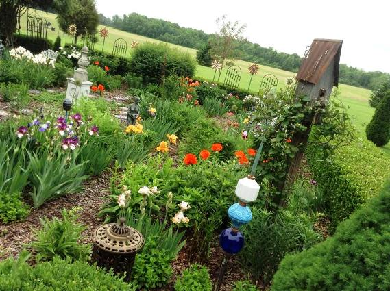 Vertical trellises and garden art are the garden's gems