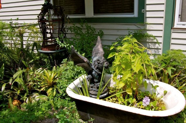 A gargoyle protects Tanya Goldmith's tub fountain