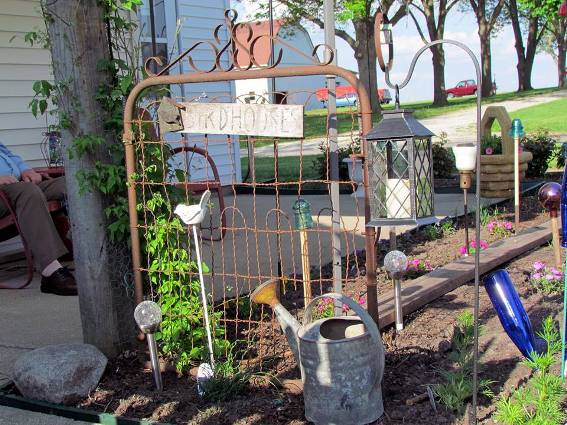 Nancy Carter uses this gate as a trellis at the end of a flower bed