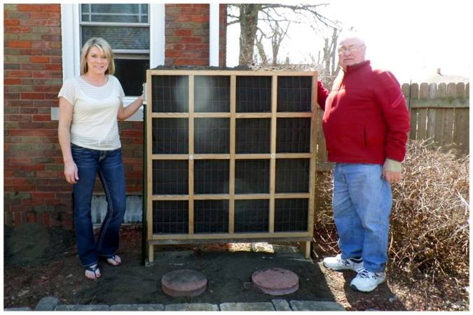 Ron Meyer shows off the construction of the planter, with Roxanne