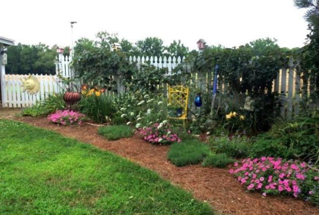 Debbie Bruening's flower border, dotted with flea market accents