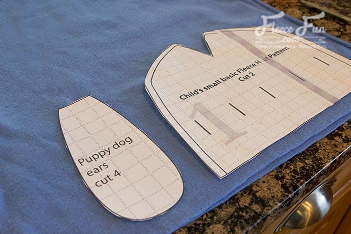 I love this easy DIY fleece hat. It's a cute puppy hat that would be easy to sew up for a little kids. Great idea for making a warm hat. free fleece dog hat pattern is a great fleece sewing project. free fleece dog hat pattern