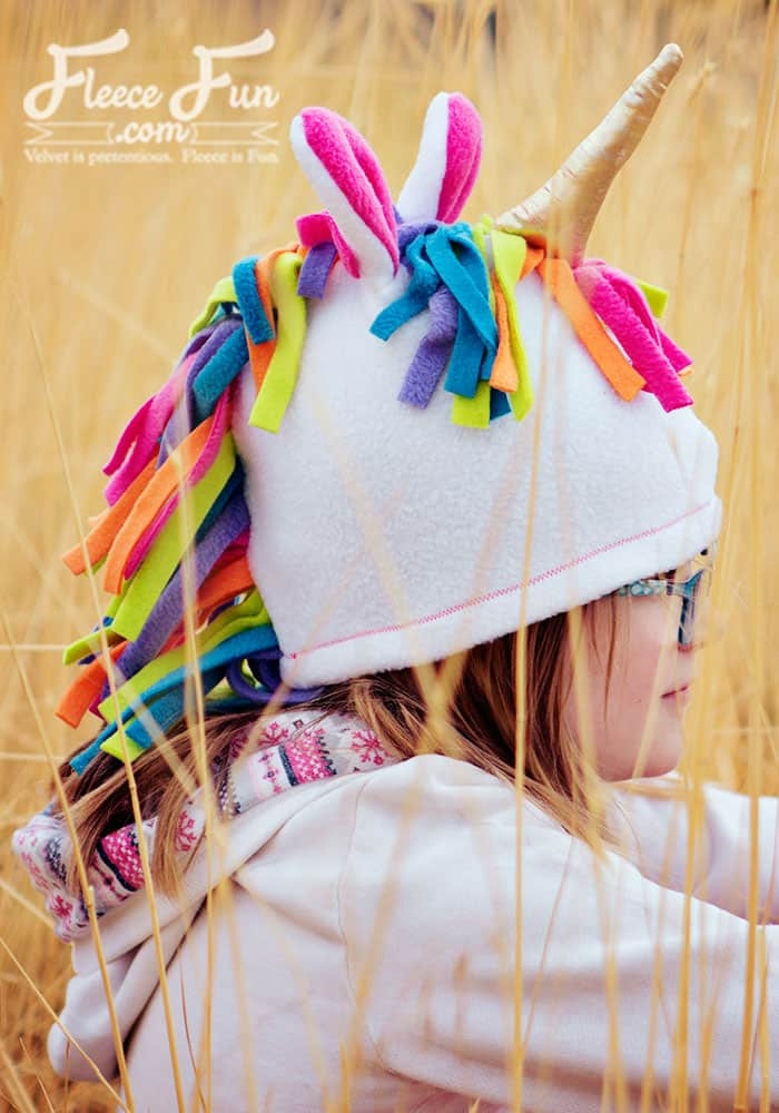This Fleece Unicorn Hat Pattern is a free sewing project. Perfect for colder weather your child will love the magical look of this fleece sewing project. Fleece Hat tutorial comes in sizes baby to adult so everyone can have the joy that is being a magical unicorn.