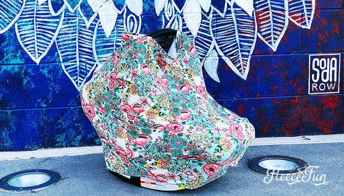 This Stretchy Baby Car Seat Cover Pattern sews up quickly! With easy to follow step by step instructions and a free sewing pattern, this easy sew will be your go to baby gift! So easy you can make several canopies in one sitting.