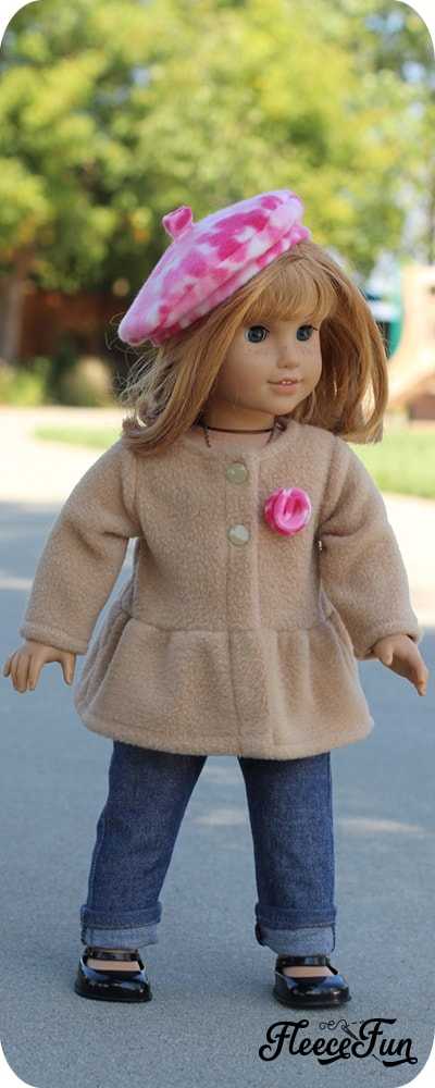 This adorable 18 Inch Doll Peplum Coat and Hat is a free pattern that is the perfect way to dress up your American Girl Doll.  Easy Sewing project with great step by step pictures to make is easy. #freesewingproject #18dollclothespatterns #americangirldolldiy #americangirldollclothespatterns #fleecesewingproject