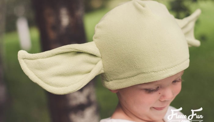 Love this cute Baby Yoda inspired hat.  The free sewing pattern comes in sizes baby to adult so everyone can enjoy it! DIY Baby Yoda Costume (The Child from the Mandalorian) #freesewingpattern #starwars #babyyoda #themandalorian #mandalorian #thechild #babyyodacostume