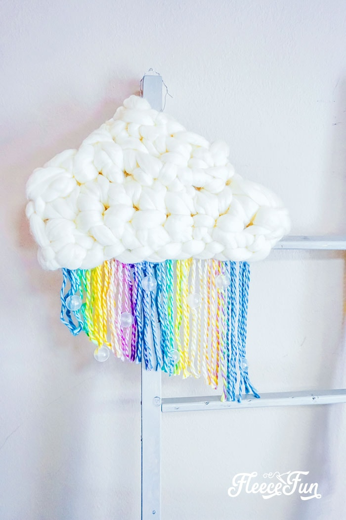This DIY Nursery Wall Hanging with Rainbow and cloud is perfect for over the crib! Easy to make  decoration for the nursery. Step by step instructions!