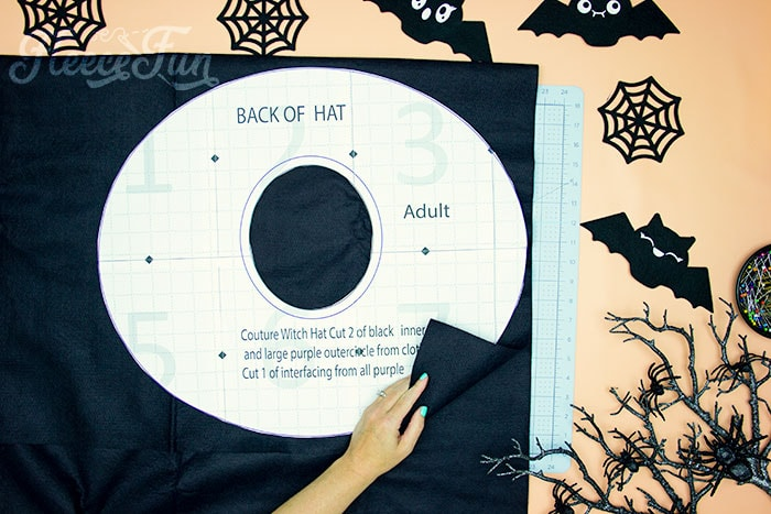 brim of hat being cut out. Learn how to make a witch hat with this free pdf pattern and step by step tutorial. This couture style hat is sure to be a favorite year after year.