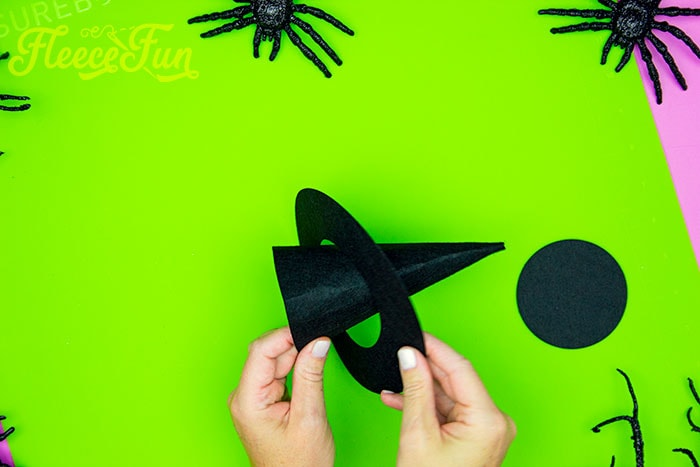 Placing the brim on the cone. This DIY Mini Witch Hat is no sew and comes with a free PDF pattern and SVG template to make it a breeze! 3 mini sizes so you can make the perfect hat!