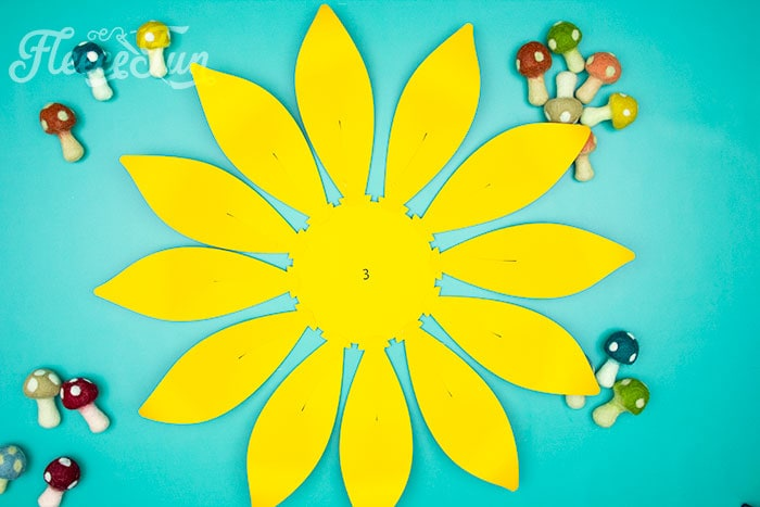 3rd row assembled. This Giant Paper Sunflower DIY (FREE SVG files) is perfect for fall! Make a Giant flower wall or use it to decorate your space! So many possibilities!