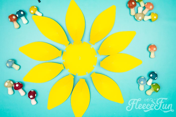 2nd row with petals to glue on. This Giant Paper Sunflower DIY (FREE SVG files) is perfect for fall! Make a Giant flower wall or use it to decorate your space! So many possibilities!