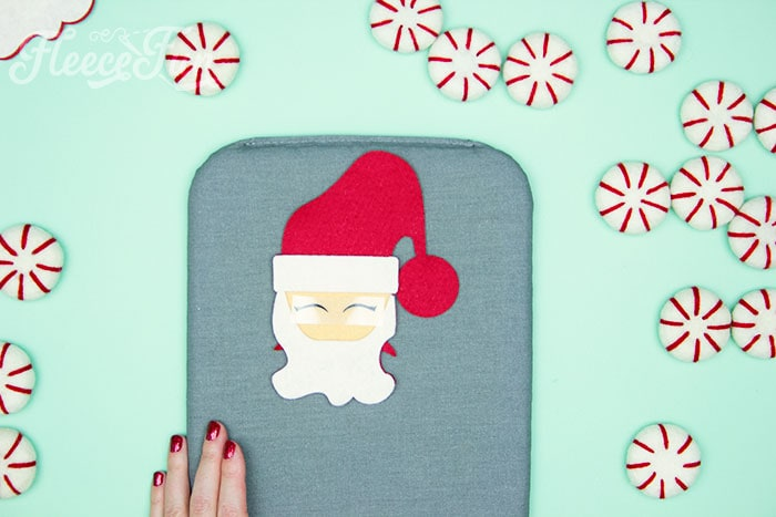Finding the placement of the eyes. Items needed. With a Free Ornament Template you can make this adorable felt Santa! This homemade ornament is no sew and makes for a wonderful gift.