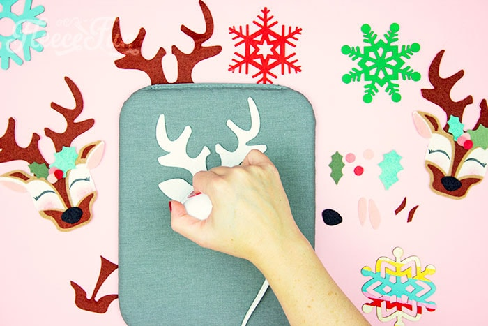 Ironing on the items with an EasyPress Mini. This adorable Felt Ornament Pattern (Free) is a wonderful way to add some color & personality to your Christmas Tree. Make with a few scraps of felt & glue!