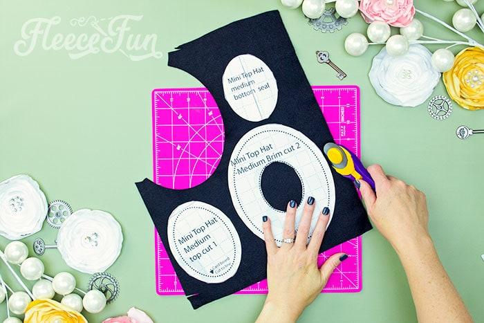 cutting out the pattern pieces. Learn how to make a mini top hat with this free pattern and tutorial. I love that there is a sew and no sew option. The free template makes this costume idea easy to make at home.