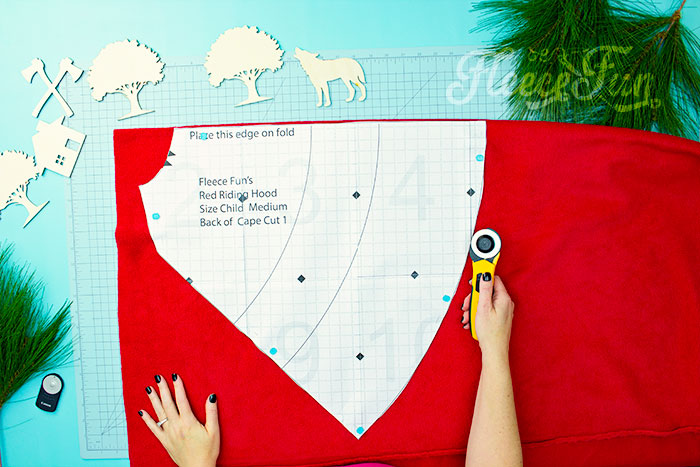 Place the pattern on the fold. Will keep the chill from nipping, but not the wolves. This cape has a video tutorial with a FREE sewing pattern. It's only six steps - looks DIY easy! Love this fleece sewing Project - Red Riding Hood Cape Pattern. It's a great costume pattern that has a classic look. It can work for different costumes. Perfect for Halloween. I love how the sewing tutorial is geared for beginners. It's a great beginner sewing project.