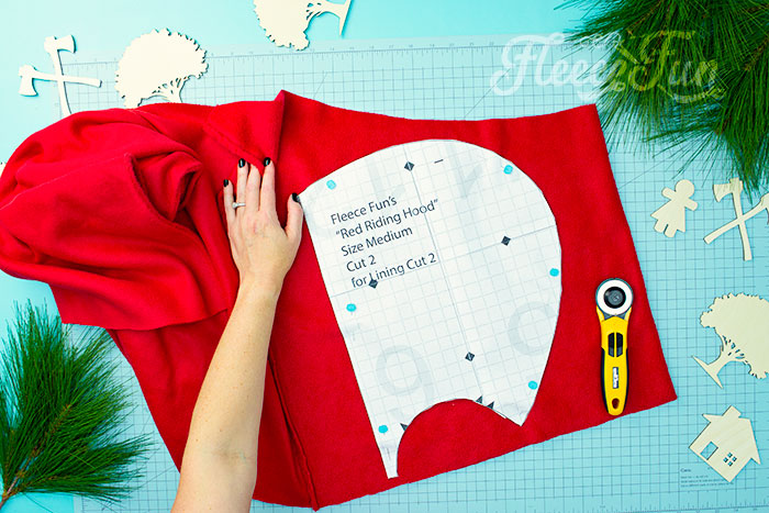 Cutting out the hood to the free cape pattern. Will keep the chill from nipping, but not the wolves. This cape has a video tutorial with a FREE sewing pattern. It's only six steps - looks DIY easy! Love this fleece sewing Project - Red Riding Hood Cape Pattern. It's a great costume pattern that has a classic look. It can work for different costumes. Perfect for Halloween. I love how the sewing tutorial is geared for beginners. It's a great beginner sewing project.