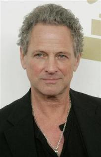 Lindsey Buckingham poses as he arrives at a Grammy nominations event in Los Angeles