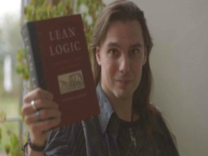 Shaun Chamberlin holding a copy of David Fleming's Lean Logic