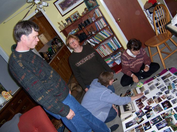 Mike, Pam, Carol and Dorcas putting photos together