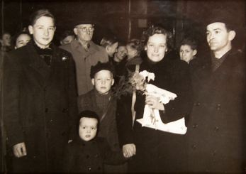 Mille, Carl and their 3 sons leaving Denmark 1953. Her father is in the background.