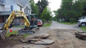 backhoe digging trench - backhoe-digging-trench