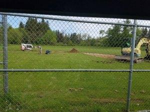 equipment behind fence - equipment-behind-fence