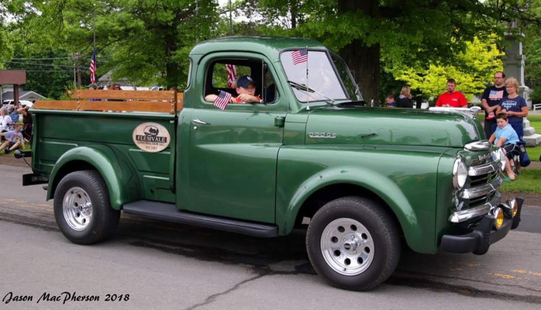 fb green truck - About Us