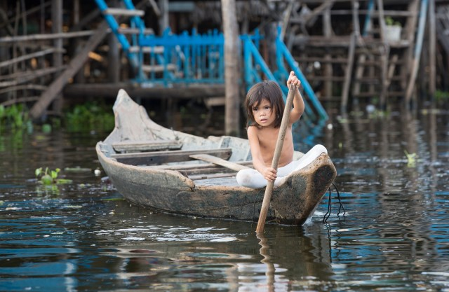 Girl Getting Groceries, Floating Village, Cambodia