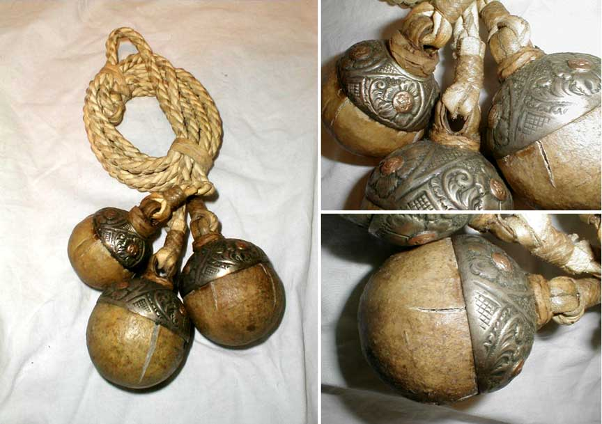 bola or boleadoras from argentina with silver and copper caps