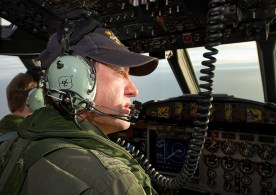 Royal Australian Air Force Warrant Officer Ron Day scans the ocean from the flight deck of an AP-3C Orion over the southern Indian Ocean search area as part of the Australian Maritime Safety Authority-led search for Malaysia Airlines flight MH370. Image: © Commonwealth of Australia, Department of Defence