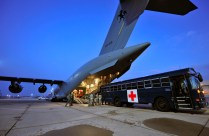 At dawn a US medical transport bus pulls up to the RAAF C-17 at Ramstein Airbase in Germany. The bus travelled a short distance from the US Landstuhl Regional Medical Centre with the seven wounded Australian soldiers