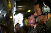 Royal New Zealand Air Force (RNZAF) Air Warfare Specialist, Flight Sergeant Simon Martelli, operates the radar and electro optics camera of the P-3K2 Orion during a search mission over the southern Indian Ocean in support of the Australian Maritime Safety Authority-led search for Malaysia Airlines MH370