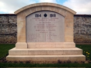 This monument within the cemetery says that the cemetery was originally made for 1 American, 60 British and 72 French World war 1 servicemen.