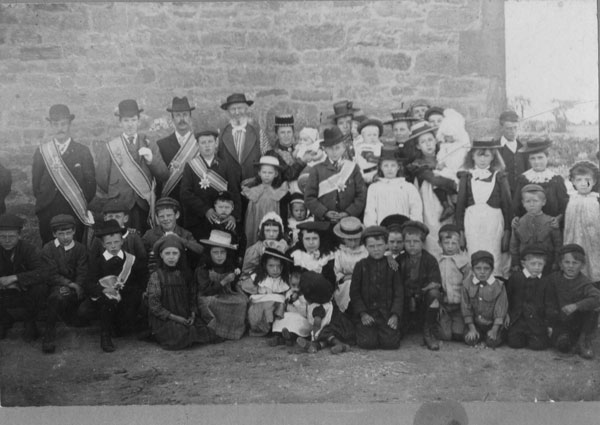 What on earth this is about, we can't begin to guess. What are the sashes about? Can anyone help? Again, Isabella Piercy is there, standing right of centre with a brooch at her throat and wearing a straw hat. She is holding baby Griffith who has a dark hat on. This would be circa 1898 and it is in Sychdyn.
