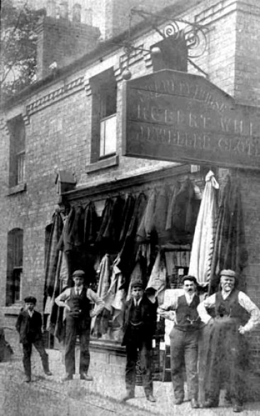 Mr Robert Williams and employees outside his pawnbroker's shop (c1901/03)