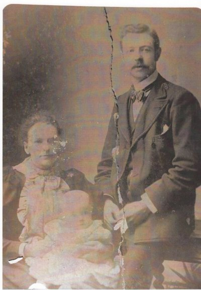 William Arnold Huson as a baby with his parents