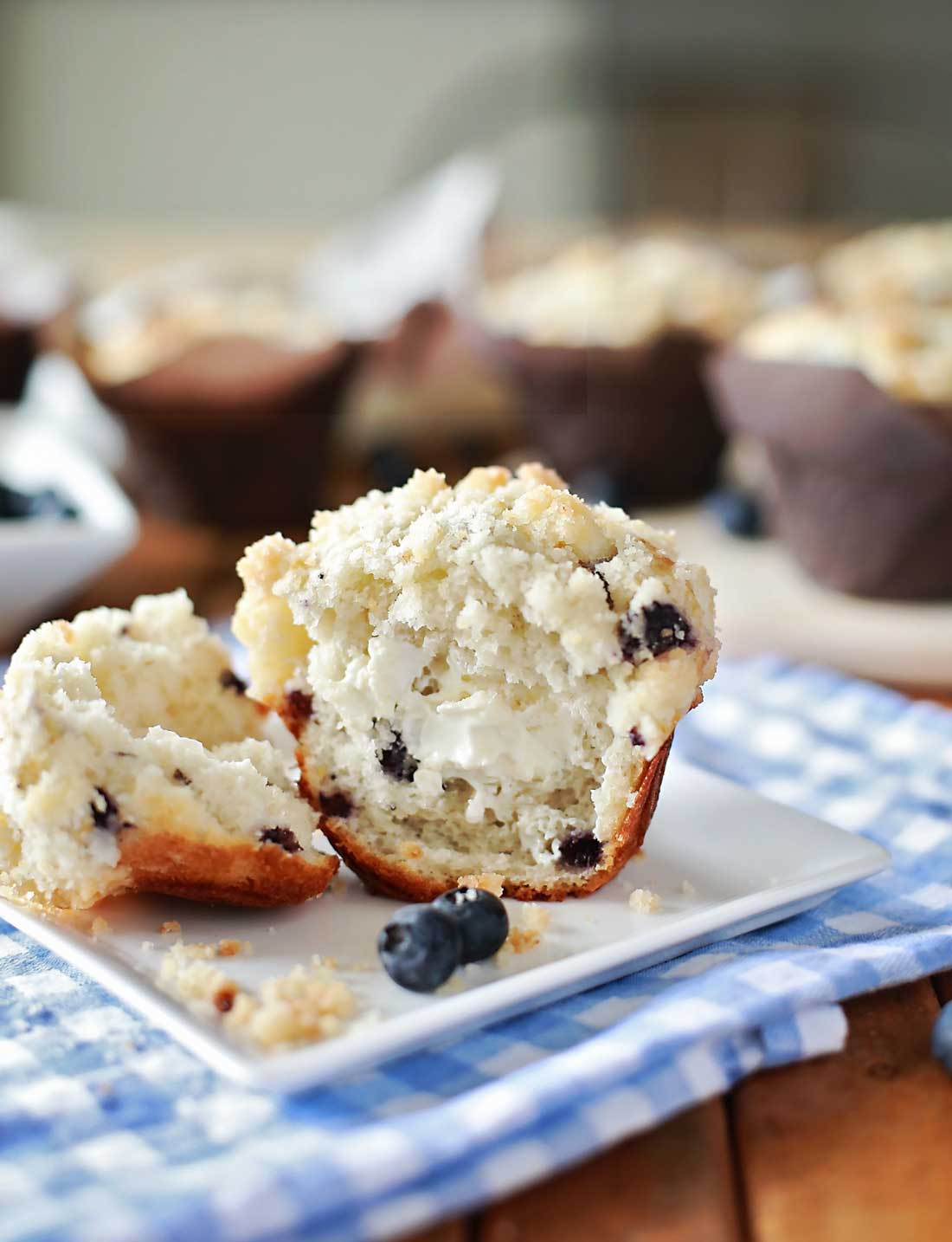 Blueberry Mufins with cream cheese and topped with streusel by Flirting with Flavor