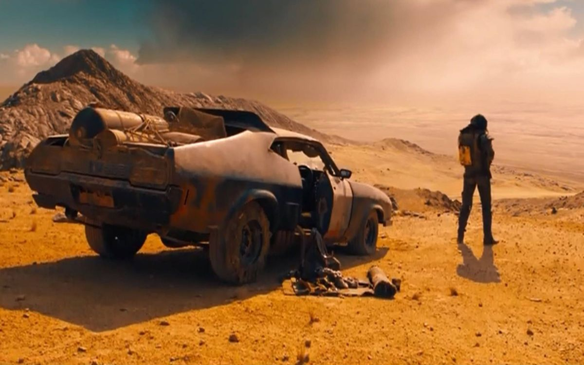 A person standing next to a truck in Mad Max: Fury Road