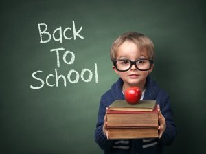 http://www.dreamstime.com/stock-photos-back-to-school-young-child-holding-stack-books-written-chalk-blackboard-image36820783