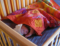 baby sleeping on natural latex crib mattress